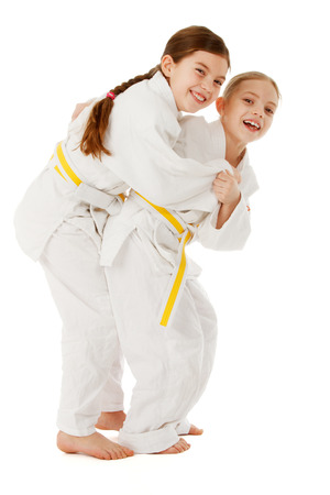 Kids training judo and having fun, studio shoot. Stock Photo