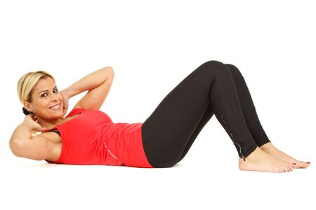 situp: Sporty girl doing situp and smiling, on white