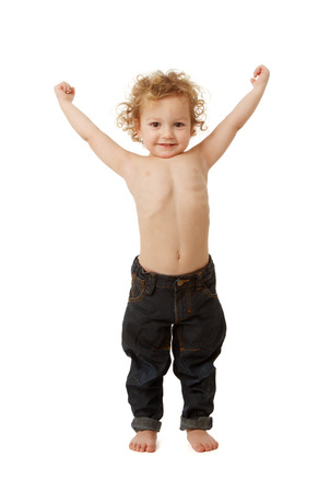 boy muscles: Young boy showing off with his muscles