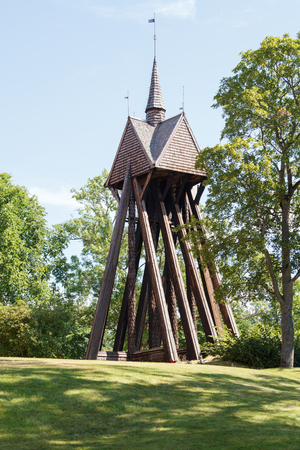 church bell: Old church bell tower made of wood. Stock Photo