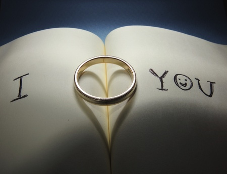 Wedding ring on a letter of love  Stock Photo - 17721521