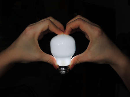 ignited: The bulb is ignited in a hands