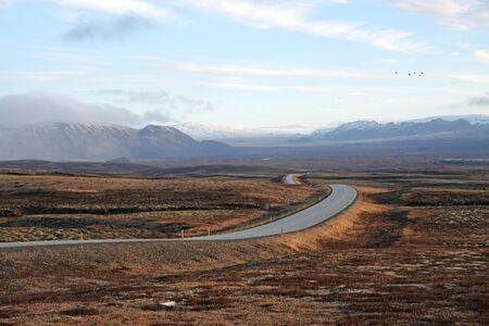 beautiful road across the Iceland going far