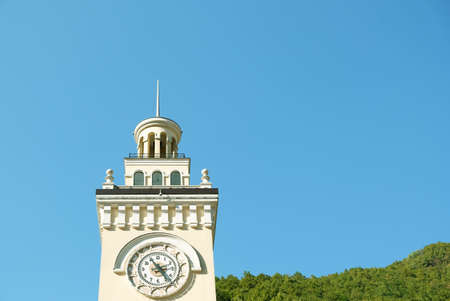 Clock tower in Rosa Khutor, Sochi, Russia. The top of the tower against a blue sky