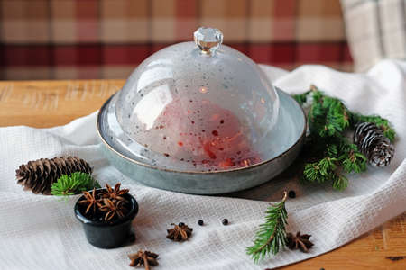 Meat under a glass cloche with vegetables, giving about the steam. Lunch time.