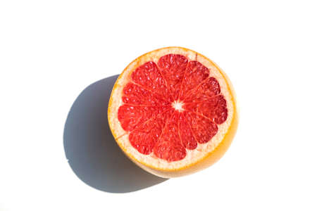 Red orange close-up, isolated on a white background with a shadow.