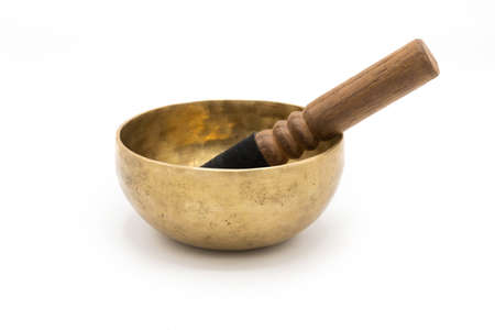Handmade Tibetan singing bowl with a stick, isolated on a White background