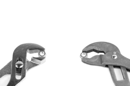 crescent wrench: Wrenches  and nuts isolated on white background, with space for text Stock Photo