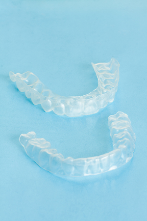 Invisible dental aligners modern tooth brackets transparent braces to straighten teeth in cosmetic dentistry and orthodontics. Used as individual tooth tray for whitening also.