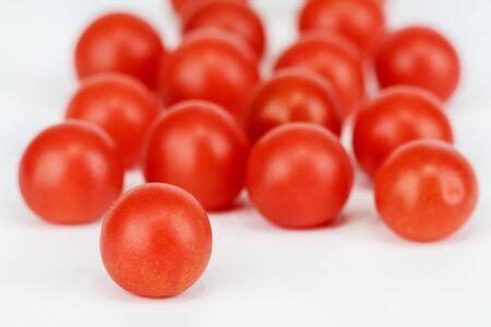 Juicy organic Cherry tomatoes on white background