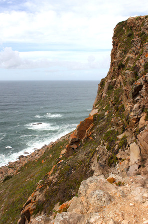 Portugal. Cabo da roca. Rock on blue atlantic ocean background. Vertical view
