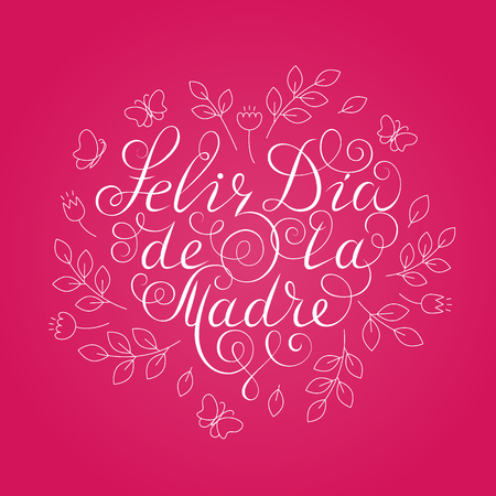 Happy Mothers Day. White ink calligraphy on pink background. Heart shape. Used for greeting card, poster design. Hand drawn spanish lettering with decoration. Feliz dia de la madre