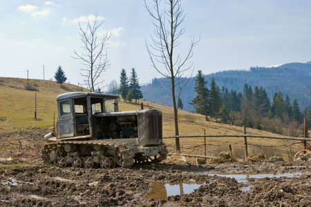 an old tractor is abandoned in dirt photo