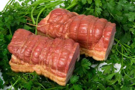 sausage wares on a background greenery, studio shot