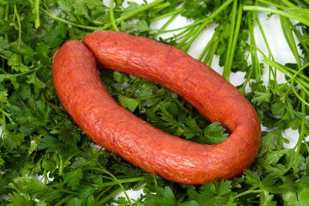 wares: sausage wares on a background greenery, studio shot