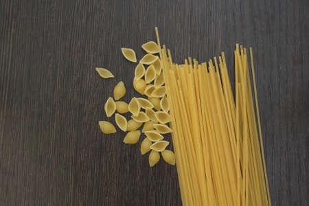 pasta on darck wooden board Stock fotó