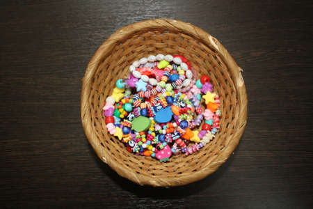 beads on a wooden basket
