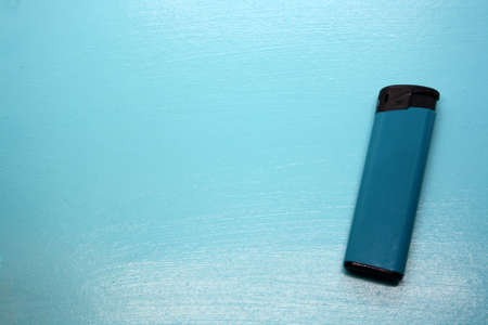 Blue lighter on a blue background. Space for text. Banque d'images