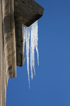 icicles: Icicles hanging from roof