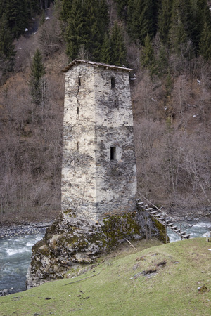 svan: Svan Ancient tower on the bank of the river, Svaneti, Georgia. Stock Photo