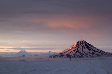 kamchatka: Volcano Vilyuchinsky during sunset. Kamchatka, Russia. Stock Photo