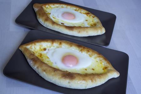 georgian: Khachapuri - traditional Georgian cheese pie.