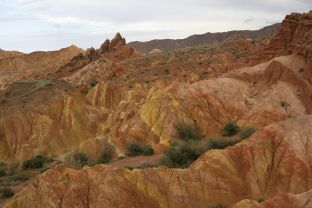 yellow  ochre: Fairy Tale Canyon (also Skazka), rock formations on the Issyk-Kul lake, Kyrgyzstan