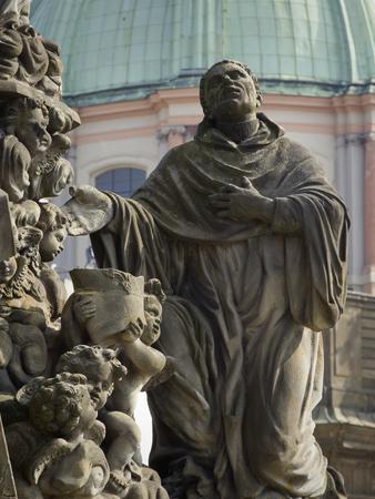 saint bernard: Fragment of the sculptural composition the Madonna with Saint Bernard. Charles bridge, Prague, Czech Republic.