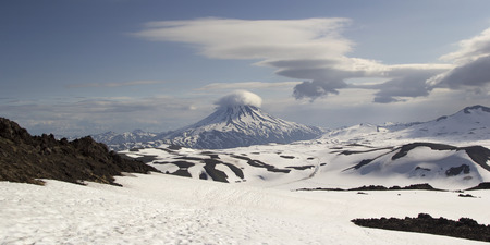 lenticular: View from Gorely volcano on  Vilyuchinsky volcano. Kamchatka, Russia Stock Photo