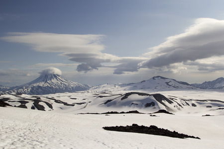 lenticular: View from Gorely volcano on  Vilyuchinsky volcano. Kamchatka, Russia Stock Photo