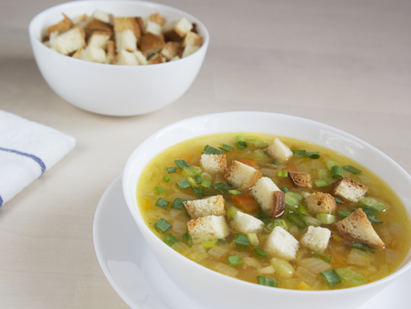 Vegetable soup with peas, carrots and onions Reklamní fotografie