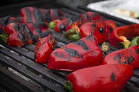 Red sweet peppers roasted on the grill.