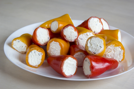 Mini peppers stuffed with cheese.