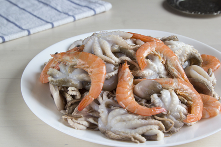 Raw seafood-mini octopus and shrimp for cooking. Reklamní fotografie