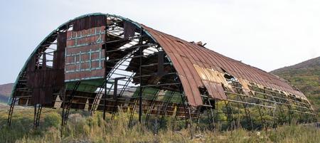 Old metal hangar in the autumn Archivio Fotografico