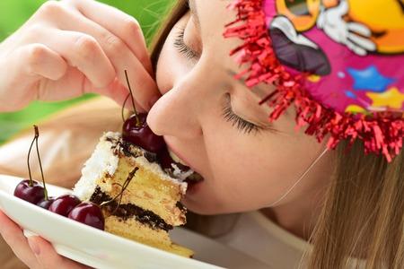 Unhealthy food. Girl eating Stock Photo
