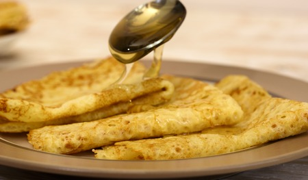 Pancakes with oil. Traditional Russian pancakes.