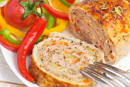 Meatloaf with vegetables. Roasted pork cooked in oven. Stock Photo