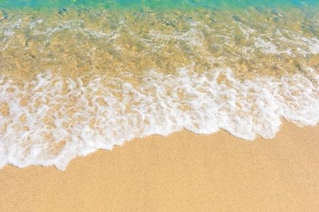Wave of blue sea on sandy beach