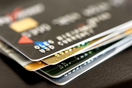 Credit card close-up. Plastic card on black background Stock Photo