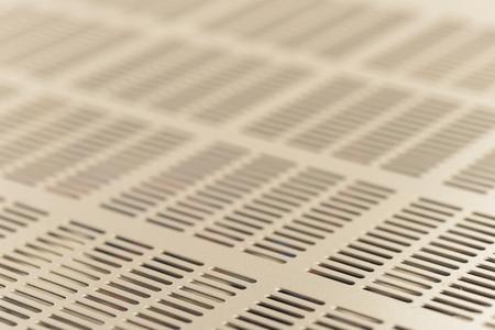 Equipment ventilation grid. Abstract metallic mesh background 版權商用圖片