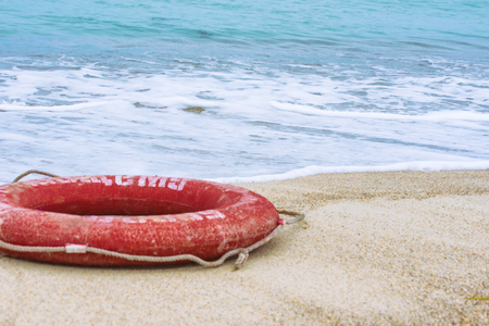 Lifebuoy on the beach. Concept of saving lives