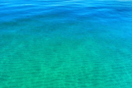 Blue and turquoise sea. Water texture. Calm and peaceful background Stock Photo