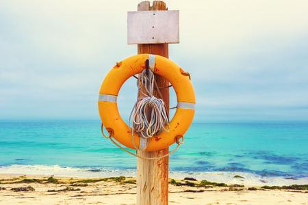 Lifebuoy on the beach. Concept of saving lives