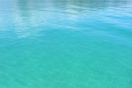 Turquoise water surface. Glare on the sea surface