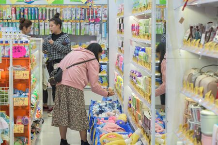 Harbin, Heilongjiang, China - September 2018: Asian woman shopping