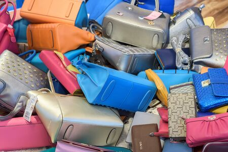 Harbin, Heilongjiang, China - September 2018: Huge pile of multi-colored bags