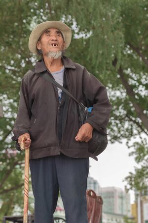 Harbin, Heilongjiang, China - September 2018: Asian old man with a cane Editöryel
