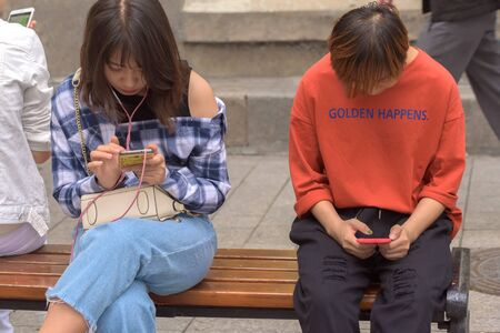 Harbin, Heilongjiang, China - September 2018: Woman using smart phone. Girls look at smartphones. Girl with phone Editöryel