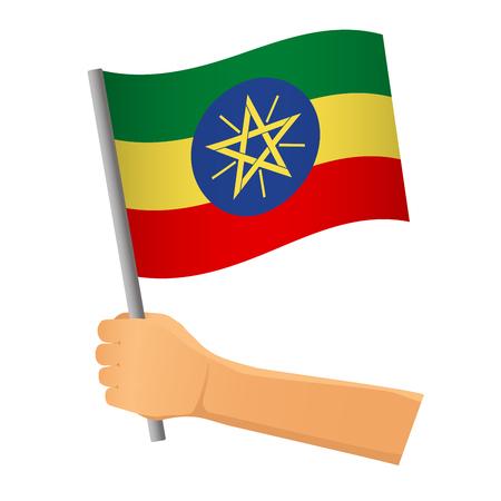 Ethiopia flag in hand. Patriotic background. National flag of Ethiopia  illustration Stock Photo
